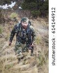 archery hunter hiking up a... | Shutterstock . vector #614144912