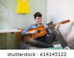 teenage boy playing guitar in... | Shutterstock . vector #614145122