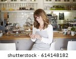 shot of a middle aged female... | Shutterstock . vector #614148182
