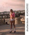 beautiful blond girl on roller... | Shutterstock . vector #614263532