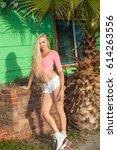 beautiful blond girl on roller... | Shutterstock . vector #614263556