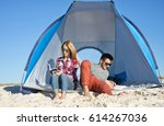 young couple relaxing on the... | Shutterstock . vector #614267036