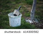 spring whitewashing of trees.... | Shutterstock . vector #614300582