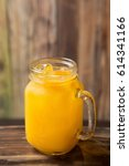 Small photo of cool peach ade with glass on table