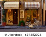 narrow cozy street in pisa ... | Shutterstock . vector #614352026