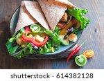 tortilla wrap or burrito with... | Shutterstock . vector #614382128