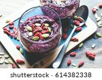 smoothie bowl with red beets ... | Shutterstock . vector #614382338