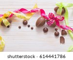 chocolate easter eggs over... | Shutterstock . vector #614441786