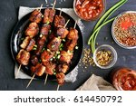 bbq meat on wooden skewers on... | Shutterstock . vector #614450792
