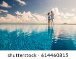 couple at the poolside against...   Shutterstock . vector #614460815