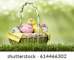 Basket With Easter Eggs On A...