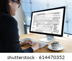 time for taxes planning money... | Shutterstock . vector #614470352