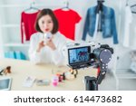 young female blogger with... | Shutterstock . vector #614473682