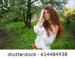 young caucasian woman holding... | Shutterstock . vector #614484938