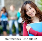 female student outdoors holding ... | Shutterstock . vector #61450132
