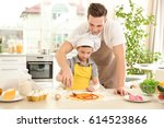 dad and son cooking at home | Shutterstock . vector #614523866