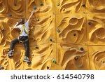 Child Boy Climbing A Rock Wall...