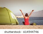 happy tourist sit near the tent ... | Shutterstock . vector #614544746