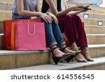shopaholic women sitting on the ... | Shutterstock . vector #614556545