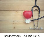 stethoscope and red heart on