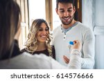 young happy couple smiling and... | Shutterstock . vector #614576666