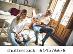 laughing couple playing duet... | Shutterstock . vector #614576678