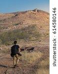 a traveler man trekking in a...   Shutterstock . vector #614580146