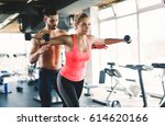 personal trainer helping woman... | Shutterstock . vector #614620166