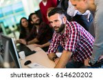 programmer working in a... | Shutterstock . vector #614620202