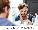 man with sensitive teeth... | Shutterstock . vector #614668055