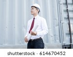 young engineer with paper plans.... | Shutterstock . vector #614670452