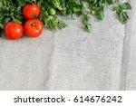 frame of fresh vegetables on a... | Shutterstock . vector #614676242