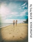 couple walk side sea | Shutterstock . vector #614679176