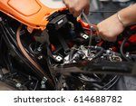 mechanic using a wrench and... | Shutterstock . vector #614688782