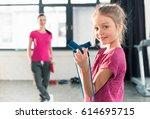 mother looking at cute little... | Shutterstock . vector #614695715