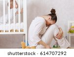 Small photo of Young mother between 30 and 40 years old is experiencing postnatal depression.
