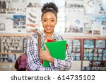 portrait of a young african... | Shutterstock . vector #614735102