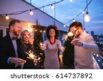 friends enjoying a rooftop... | Shutterstock . vector #614737892