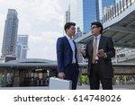 businessmen talking with... | Shutterstock . vector #614748026