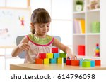 child preschooler girl playing... | Shutterstock . vector #614796098
