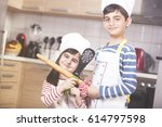 happy little chefs ready to... | Shutterstock . vector #614797598