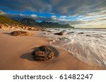 Waves Wash Up On The Beach At...