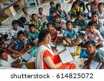 Small photo of India - March 11, 2015: Missionary woman teach poor rural indian children in the school
