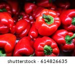 A Lot Of Red Peppers In Market.
