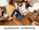 young man sitting on floor and... | Shutterstock . vector #614844536