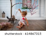 Stock photo kid playing with cat 614867315