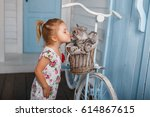 Stock photo child kiss a cat little girl have fun with kitten 614867615
