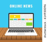 laptop with online news on the... | Shutterstock .eps vector #614930096