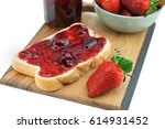bread with strawberry jam on a... | Shutterstock . vector #614931452