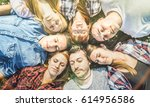 group of carefree best friends... | Shutterstock . vector #614956586